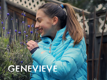 Genevieve, a teenage girl, is in a backyard smelling a sage plant and smiling. Image links to Genevieve's video.